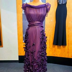 Long purple dress by Linda Lundstrom